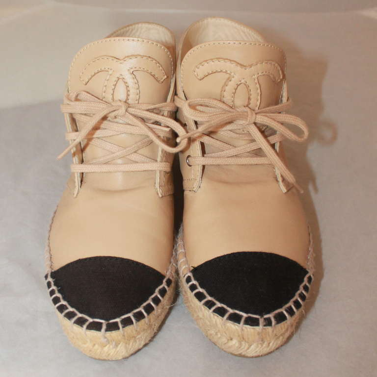 Chanel Black & Beige Leather Lace-up Sneaker Espadrille. They are a size 6 and in mint condition.