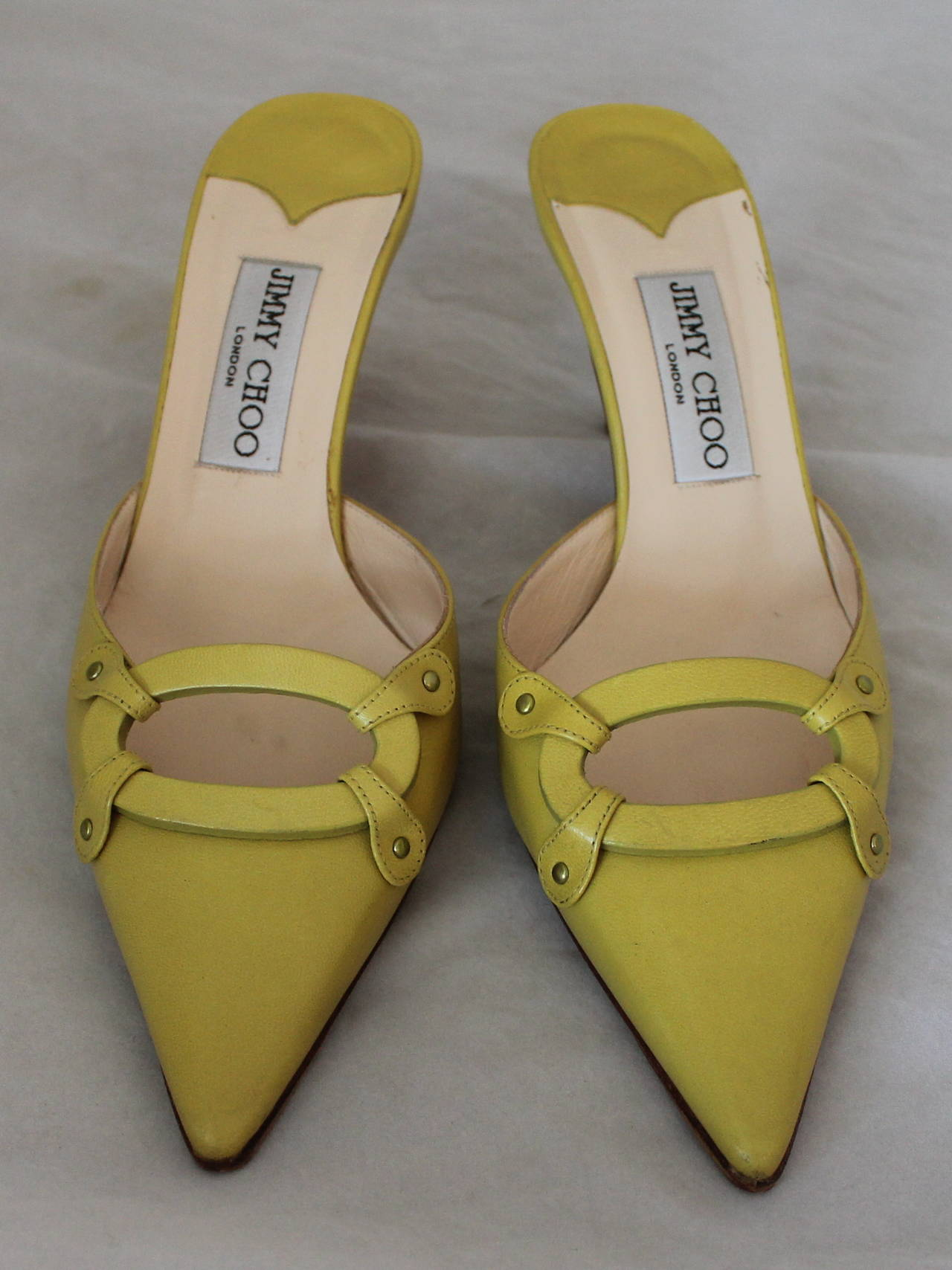 Jimmy Choo Lime Green Leather Slides with Cutout Detail - 37.5. These shoes are in good condition with the only visible wear being on the bottom.