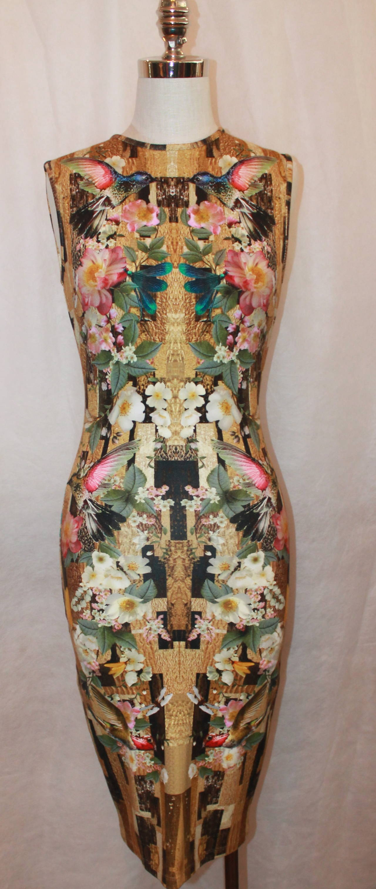 Alexander McQueen 2013 Resort Hummingbird & Floral Print Fitted Dress. This dress is in excellent condition and is a tea length. It has golden tones in the background and is 94% rayon and 6% elastin. 