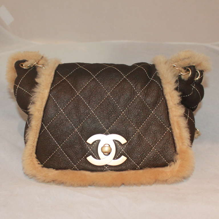 """Chanel Chocolate Brown Quilted Mini Shearling Handbag. This lambskin bag is in excellent condition and has a full fur lining. Circa 2005.  Measurements: Length- 9"""" Depth- 3.5"""" Height- 7"""" Handle Drop- 10.5"""""""