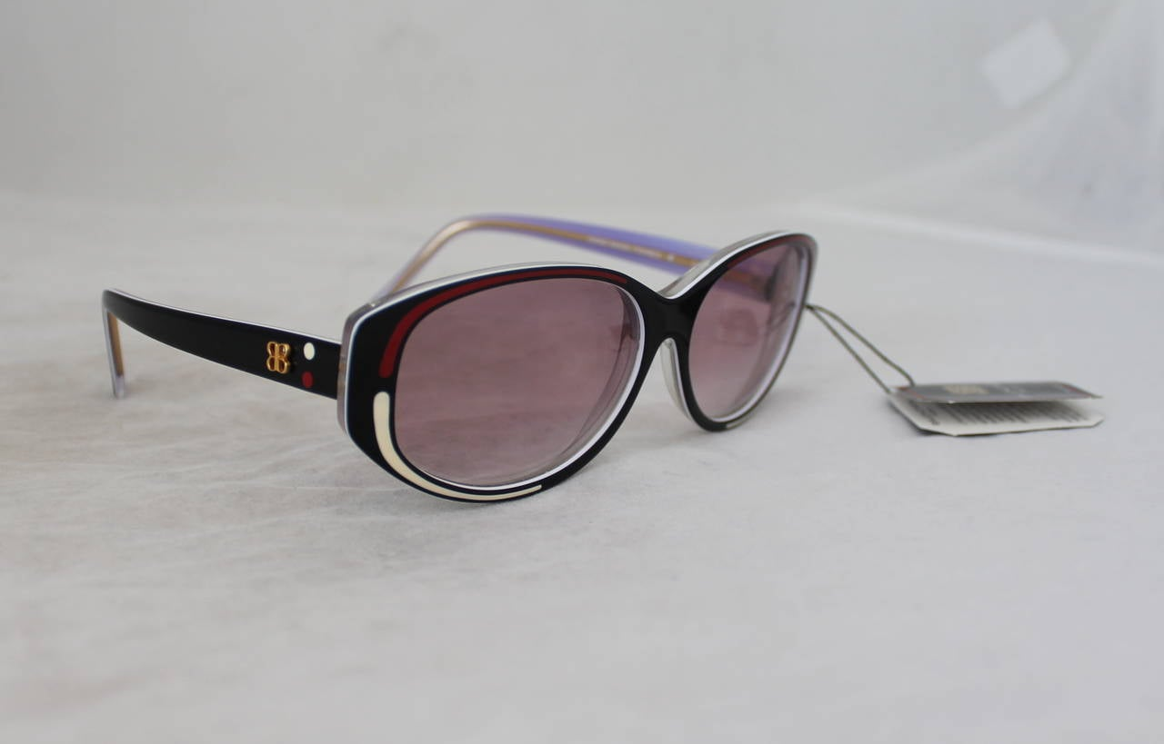 Vintage 1970s Balenciaga Black and Red Sunglasses with White Detail and Purple Lenses. These are in Excellent Vintage Condition.