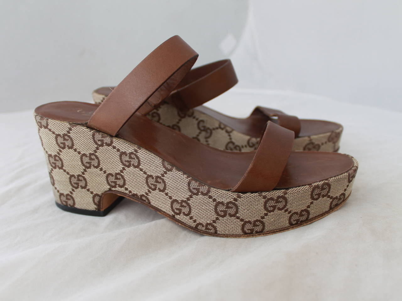 Gucci Brown Monogram Wedge Sandal - 6. These wedges are in good condition with bottom wear and markings on the inside leather (where the foot is on top of).