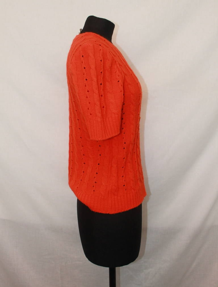 """Courreges Vintage Orange Crewneck Top - M. This sweater-top is from the 1970s and in excellent condition.   Measurements: Bust- 32"""" Shoulder to Shoulder- 15.5"""" Waist- 32"""" Sleeve Length- 10"""" Length- 22"""""""