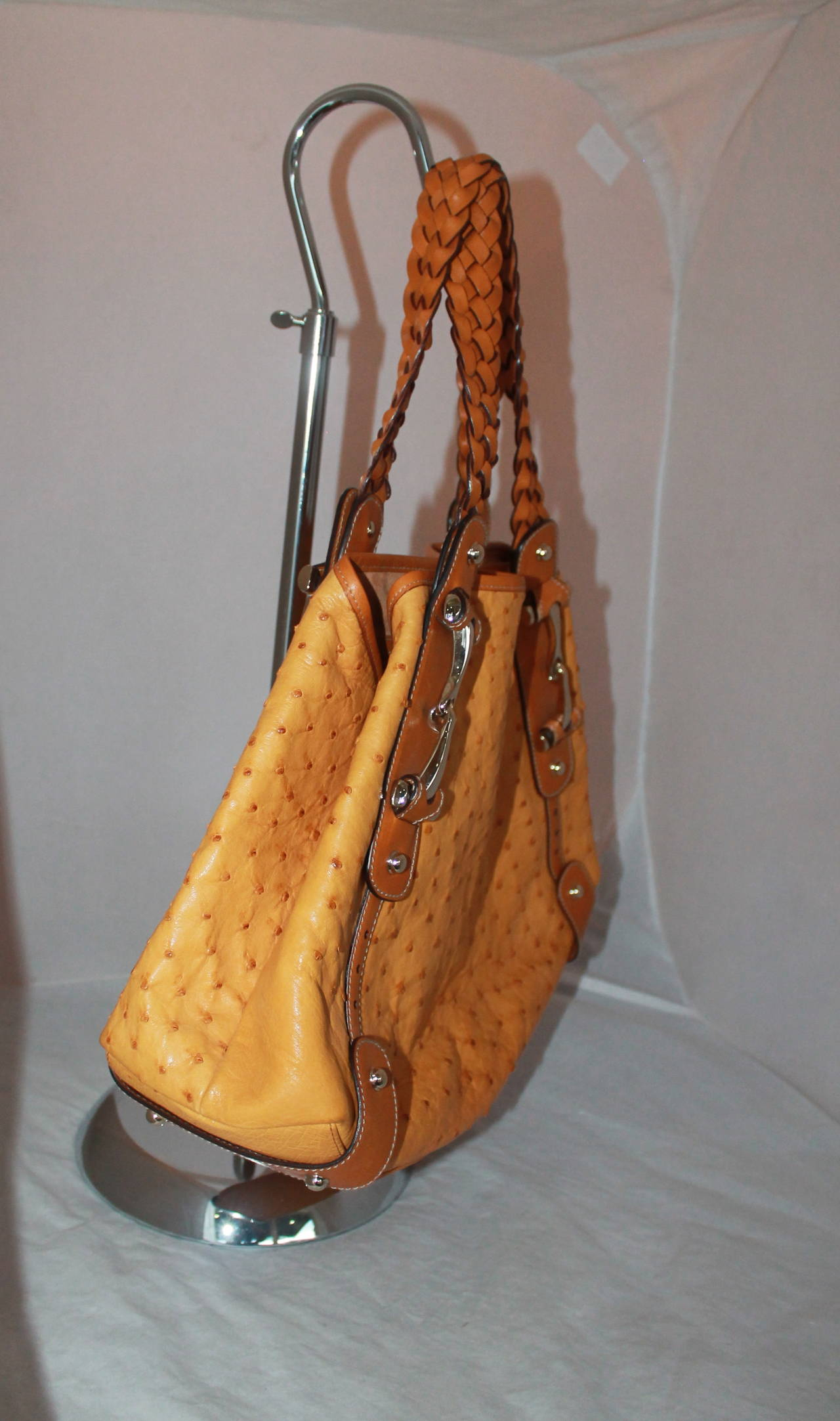 Gucci Mustard Ostrich & Luggage Braided Leather Shoulder Bag. This bag is in excellent condition with very minor wear. It is lined with suede. 