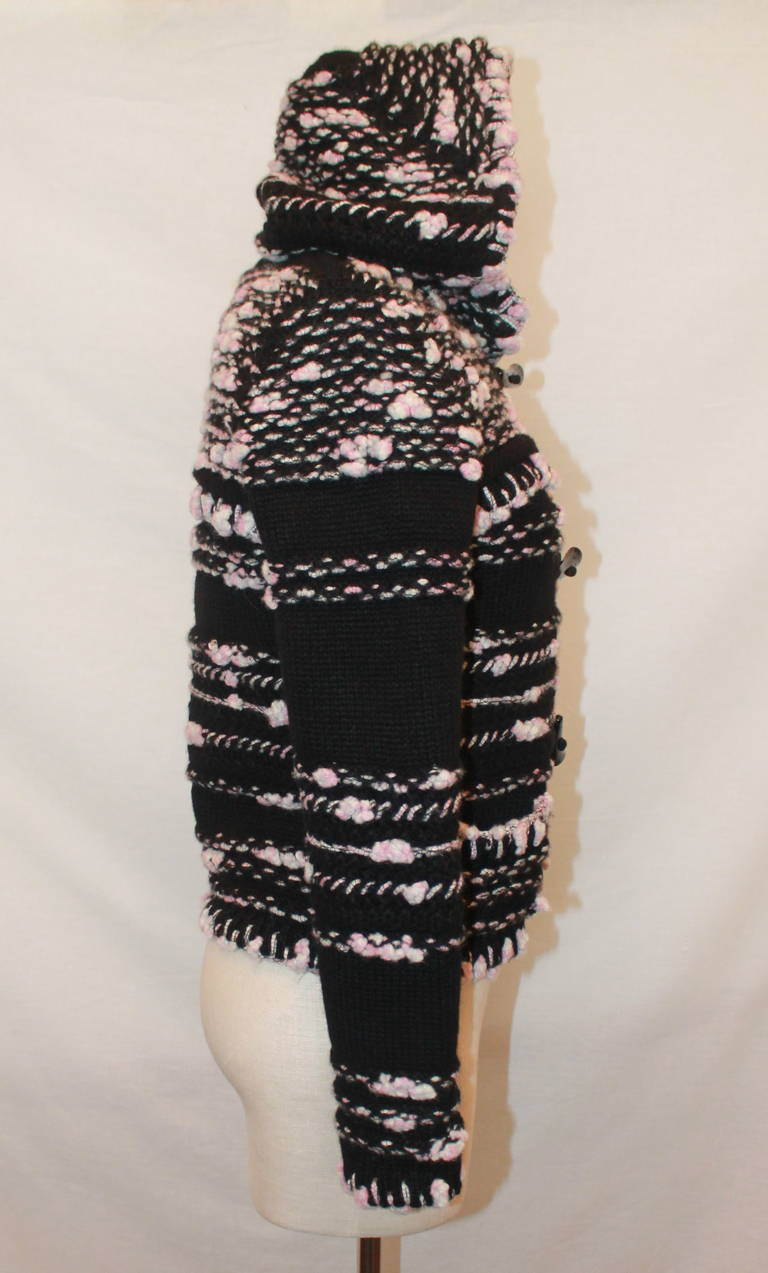 Chanel Pink & Black Cashmere Woven Sweater - 36. This hooded sweater is in impeccable condition and has black rhinestoned saber-tooth style fastens. 