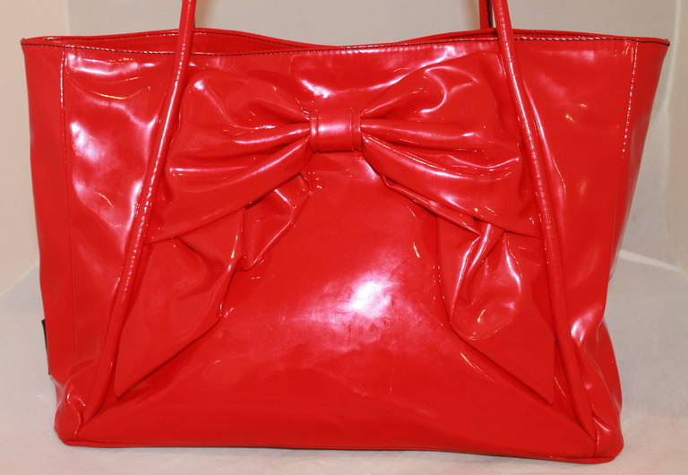 """Valentino Red Plastic Bow Bag. This fabulous bag is in impeccable condition.  Measurements: Height- 10.5"""" Width- 15"""" Depth- 6"""" Handle Drop- 6"""""""