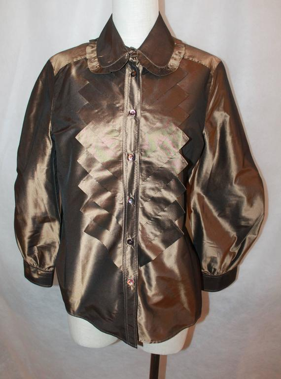 Oscar de la Renta Bronze Blouse - 12  This Oscar blouse is made of silk taffeta and is in excellent condition. It is layered in the front with a chevron fabric design. There is also a ruffle trim on the collar and has large sleeves.