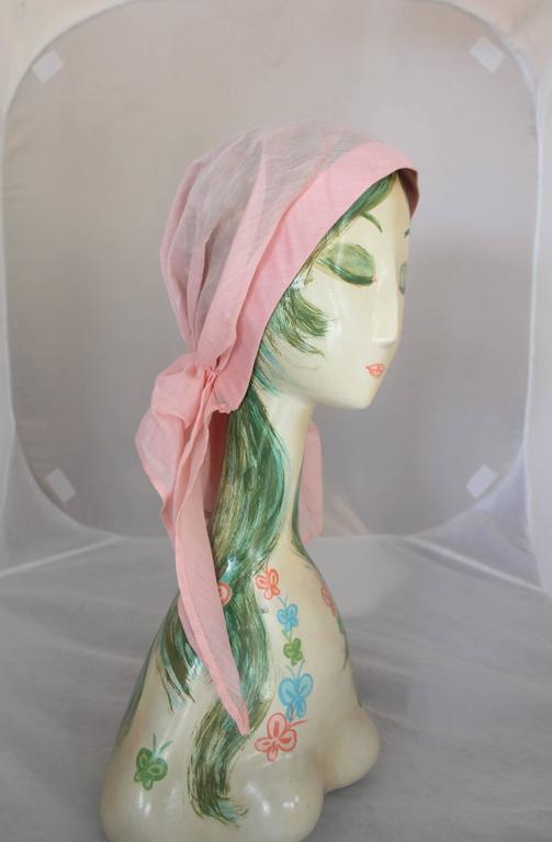 Chanel Pink Cotton Sheer Turban Hat - circa 1980's. This piece is in excellent vintage condition and is the perfect piece for spring! It fits around the head and bunches up at the base of where the head would be and drapes down at different lengths.
