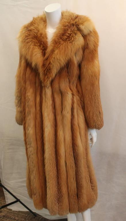 Custom Full Length Golden Fox Fur Coat - M/L. This piece is in excellent condition and still has the name of the previous owner stitched on the inside lining. 
