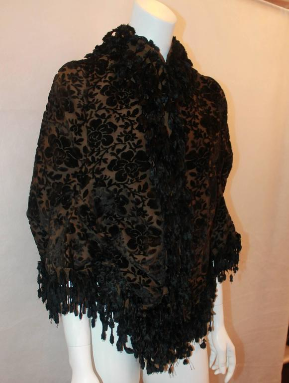 "Victorian 1890's ""La Belle Epoch"" Black & Brown Floral Cut Velvet with Fringe Jacket - S/M. This piece is in excellent vintage condition and is very rare. It hangs on the body like a shawl with very short sleeves & hook closures. It also has one"