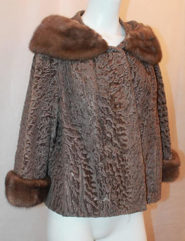 Vintage Brown Persian Lamb Jacket with Mink Collar & Cuffs - M. This piece is in fair condition due to a tearing in the inside lining seen in image 5 near the neck, everything else is in excellent vintage condition. It has 2 pockets near the front