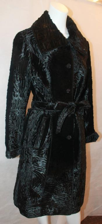 Marengo Black Broadtail Collared Full Coat with Belt - L. This coat has 2 front pockets and black rhinestone buttons. It is in excellent condition. 