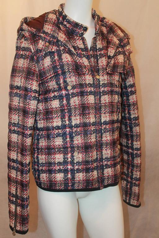 Chanel multi plaid puffer jacket w/ removable hood - Sz 46 - NWT - Circa 2013 The plaid on the jacket is a combination of pink, purples and ivory. It has a detachable hood, front zip and 2 front zipper pockets. Also zips on the ends of the cuff. NWT