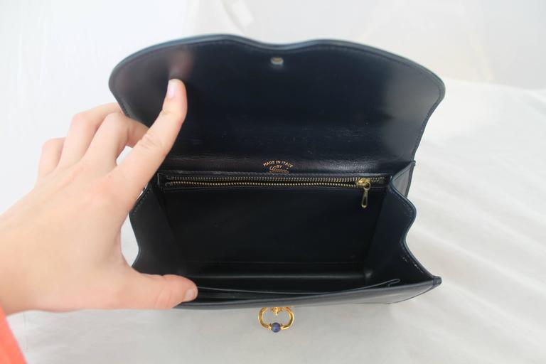 Gucci Vintage Navy Leather Clutch - GHW - Circa 1950's In Excellent Condition For Sale In Palm Beach, FL