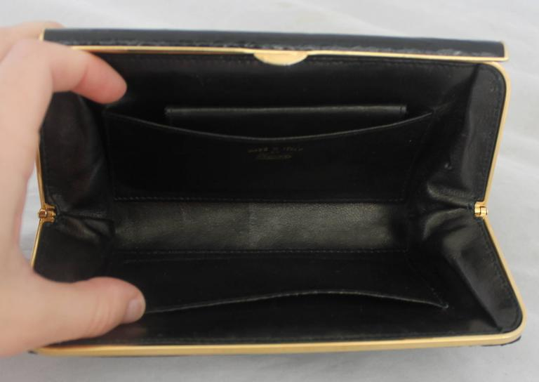 gucci vintage black small alligator clutch - ghw