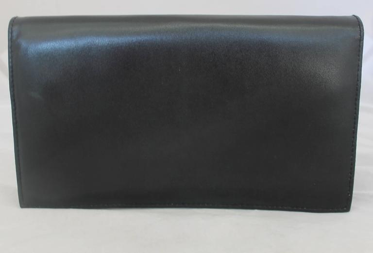 Christian Dior Vintage Black Leather with Gold Hardware Clutch, Circa 1980s In Fair Condition For Sale In Palm Beach, FL