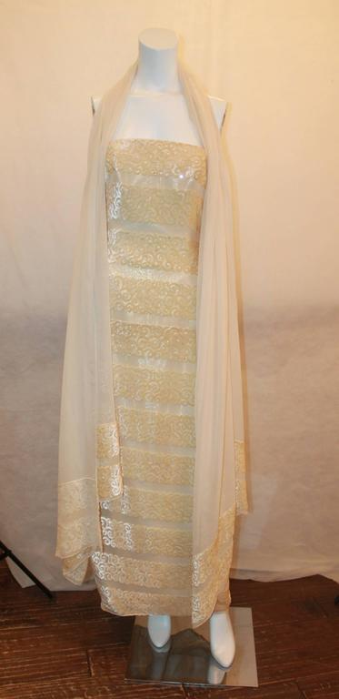 Michael Casey Silk Chiffon & Ivory Cut Velvet Strapless Gown - 10.  This gorgeous gown is in excellent condition.  It features a gorgeous ivory silk chiffon material, paneled velvet swirls, a straight across neckline, a gathered bustled back with