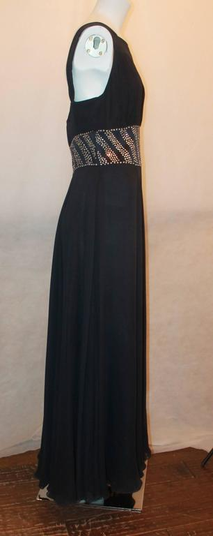 Reem Acra Navy Silk Chiffon Gown w/ Rhinestones, Ruched Bust, & Keyhole Slit -10.  This beautiful gown is in good condition with only a slight run on the left lower side.  It features a gorgeous navy silk chiffon, rhinestone detail around the waist,