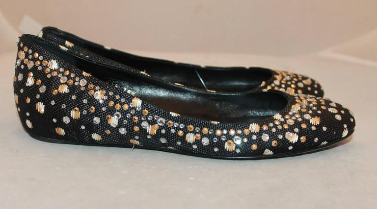 Valentino Black Raffia Ballerina Style Flats w/ Rhinestones - 38.5.  These shoes are in very good condition with some wear to the sole consistent with their use.  They feature a lovely black raffia material, a ballerina style look, and some