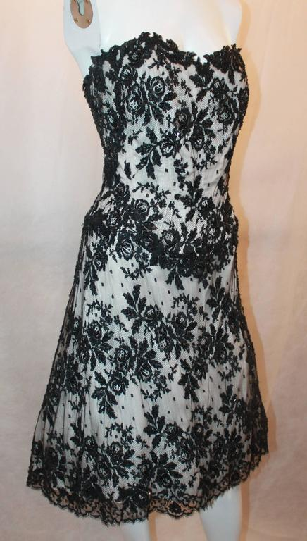 Vicky Tiel Black & White Lace Strapless Dress w/ Beading - 44.  This beautiful dress is in excellent condition.  It features a gorgeous black lace over a white nylon blend, a built-in corset to the hips, beading detail, a chiffon lining, and a