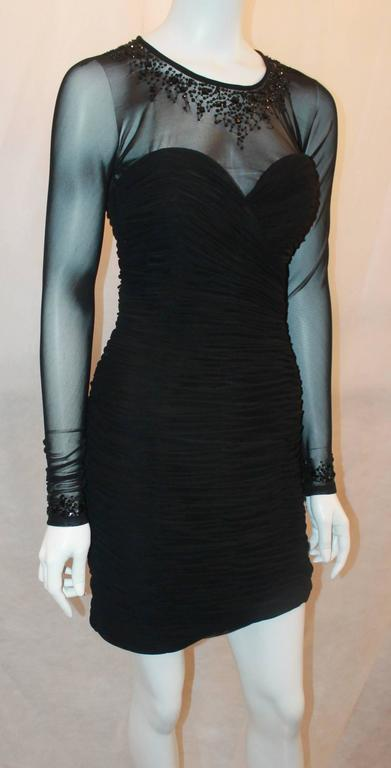 Vicky Tiel Black Jersey Cocktail Dress w/ Beading Around the Neck & Wrists - 6.  This gorgeous dress is in excellent condition.  It features a lovely black silk jersey, beading around the neck and wrists, sheer mesh, a back top button, and it is