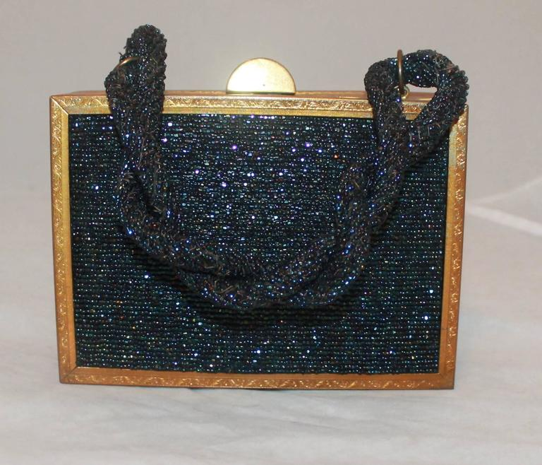 Evans Navy & Gold Vintage Beaded & Metal Rectangular Handbag - Circa 1950's.  This handbag is in good vintage condition, through age it became slightly unaligned.  It features a goldtone metal frame and lovely navy multi beading.  Also, the handle