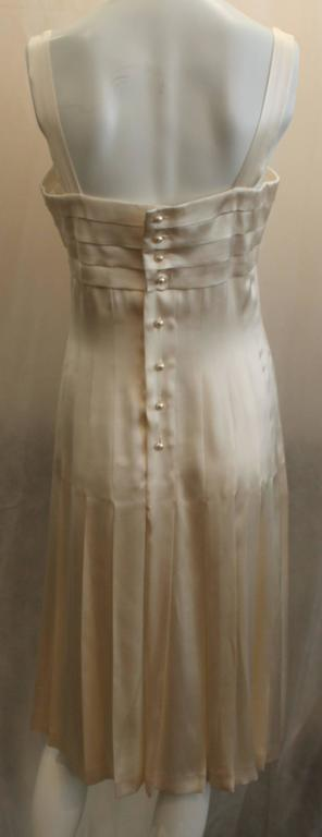 Chanel Ivory Silk Pleated Flapper Inspired Dress - 40 - 05P In Fair Condition For Sale In Palm Beach, FL