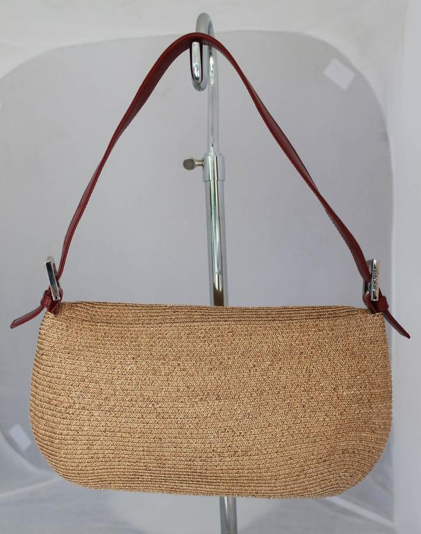 "Fendi Beige Raffia & Red Leather Baguette - SHW. This bag is in excellent condition with its closure being the ""FF"" monogram with beige enamel. The bag comes with its original duster.