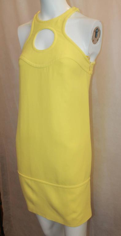 Emilio Pucci New Yellow Halter Dress with Keyhole - 38. This dress is in excellent condition and is perfect for spring and summer. This dress has a thick cotton fabric with 2 side pockets. It has one speck in the front which cannot be seen unless