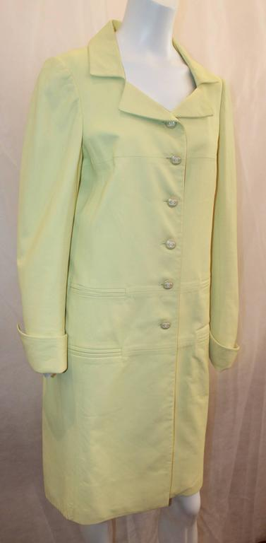 """Chanel Chartreuse Lambskin 3/4 Coat - 40 - 04C. This beautiful 3/4 coat has 4 pocket slits, big """"CC"""" buttons, long sleeves and a collar. It is in very good condition with 1 mark on the inside of one of the sleeves, minor wear, and a mark"""