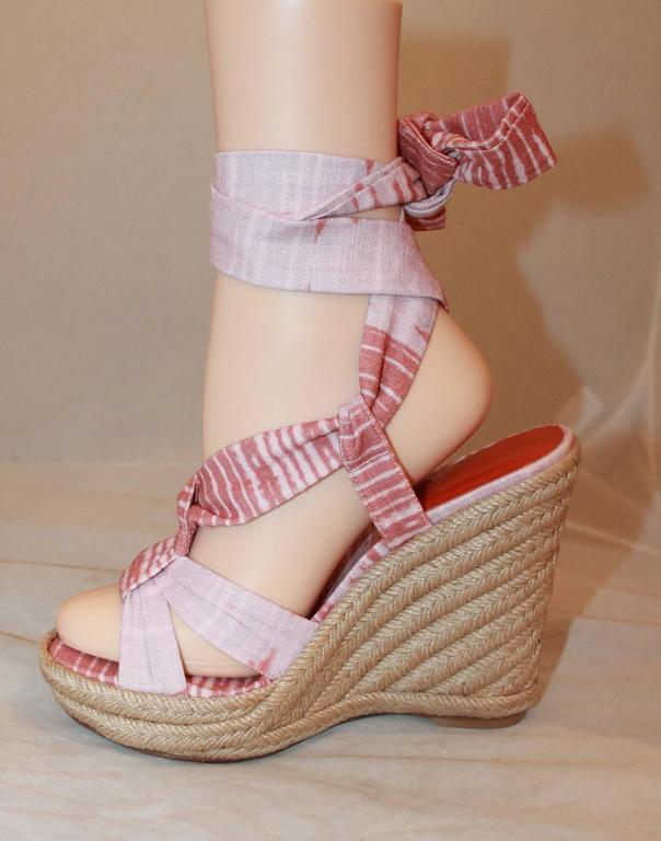 Stuart Weitzman Coral and Pink Canvas Printed Espadrille Tie-Up Wedges - 6.5. These printed wedges have a sole that was re-covered and feature pink and coral ribbon on the top of the shoe that tie up around the ankle. They are in new