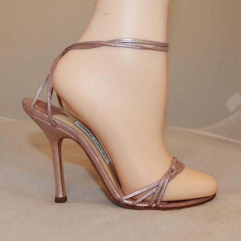 Jimmy Choo Rose Gold Woven Thin Strap Sandals with Ankle Strap - 37. These elegant heels have an ankle strap and have multiple thin, woven straps on the top. They are in good condition are show general wear along with minor bottom wear.