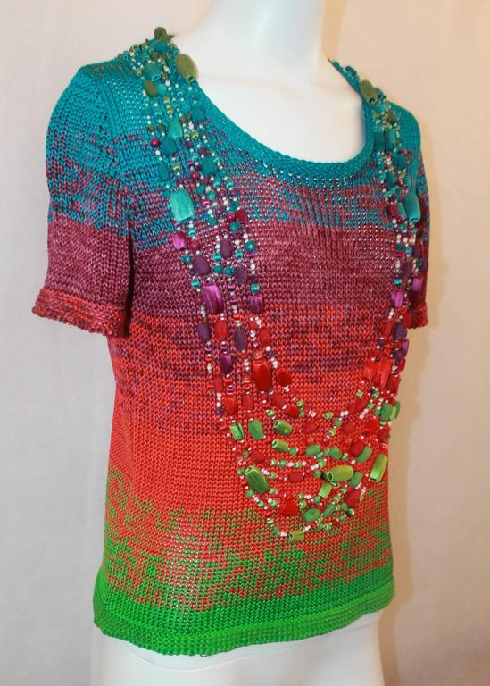 Oscar de la Renta Multi-color Silk Knit Beaded Top - S. This unique piece is the perfect pop of color for an outfit. The top is in very good condition with minor wear and some threads starting to come loose. It features a thick knit, short sleeves,