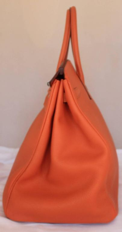 Hermes Orange Clemence 40cm Birkin - SHW- Circa 2009 This bag is in excellent condition, and just came back from the Hermes Spa Treatment. Comes with duster and box.  Measurements: Width: 40 cm Height: 30.5 cm Depth: 21 cm Handle Drop: 10.5 cm
