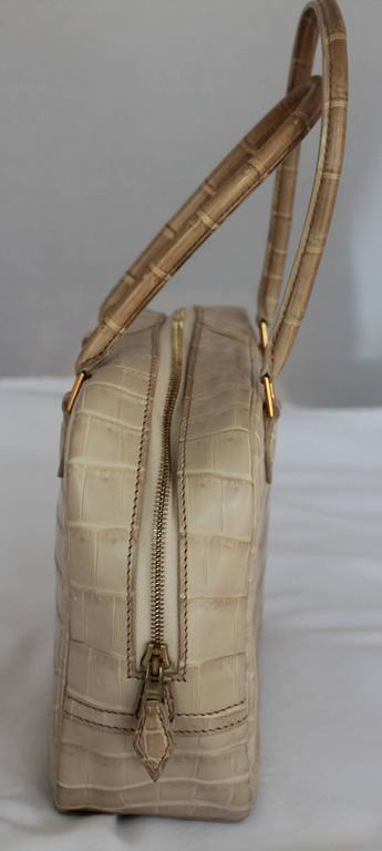 Hermes Beige Crocodile 20cm Plume Handbag - GHW - 2003  This handbag has gold feet and gold hardware. Both handles have slight discoloration due to wear. Comes with Duster. 