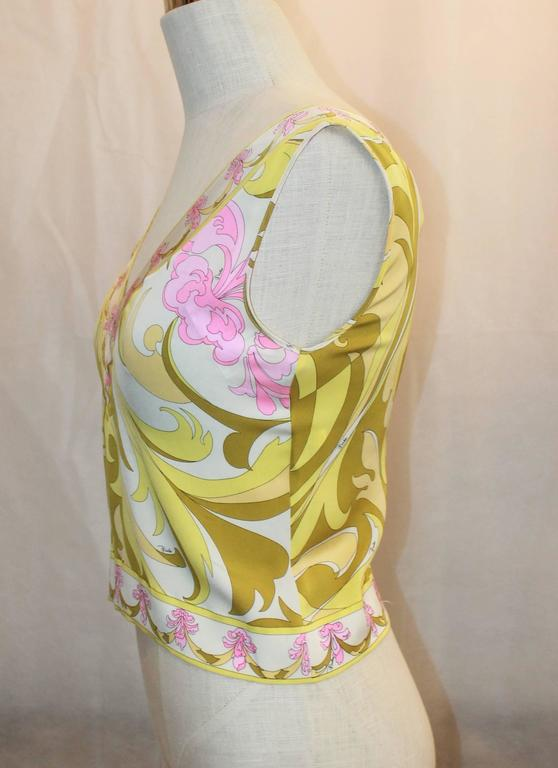 Emilio Pucci Yellow, Green & Pink Printed Sleeveless Top - 4 - 1980's This top is in excellent vintage condition with minor wear, mainly small pulls. It features a v-neck, floral printed trim, and no zipper.