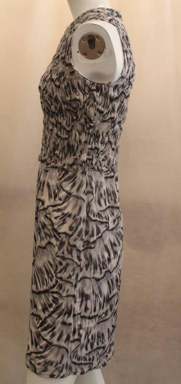 Bottega Veneta Silk Gray Animal Printed Sleeveless Ruched Dress - 40. This dress features black embezzlement on the neckline, a ruched bodice, and a sheer bottom. It has a black and dark gray animal print. It is is good condition. There is one