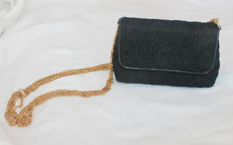 Chanel Black Lace Soutache and Leather Evening Bag - Circa Late 1980's. This beautiful, vintage, Chanel evening bag can be worn over the shoulder or as a crossbody. It is in very good condition and features a single flap, six gold strands with