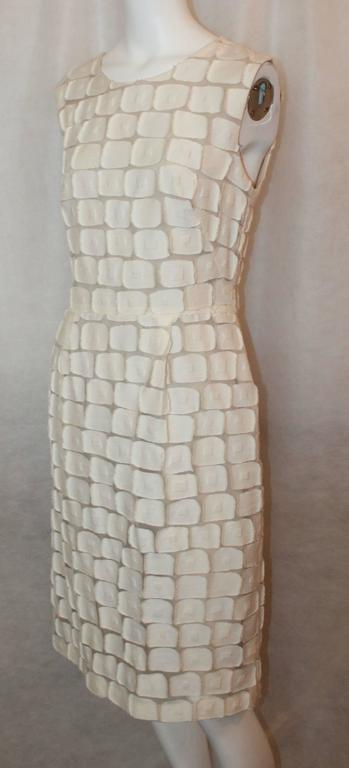 Lela Rose Ivory Cotton Blend Sleeveless Patchwork Dress - 8. This fitted dress is in excellent condition and has a unique look. The patchwork is comprised of squares and the piece has front pleats. The dress has a back