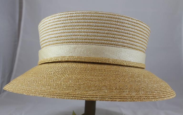 Suzanne Custom Millinery Tan Straw Hat with Thin Ivory Stripes. This hat is a straw hat with thin ivory stripes on the top. There is a down turned, tan, brim. It is in excellent condition with one small stain on the inside that is not