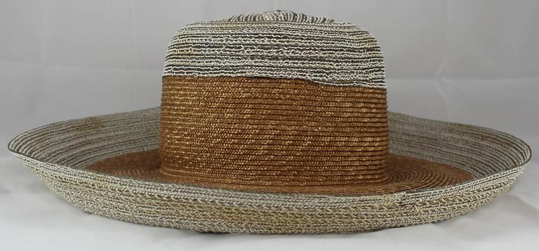 Suzanne Couture Millinery Ivory and Beige Straw Hat. This cute hat is great for the summer!  It is ivory with a thick beige band in the middle. It is in good condition with faint staining (see pictures).