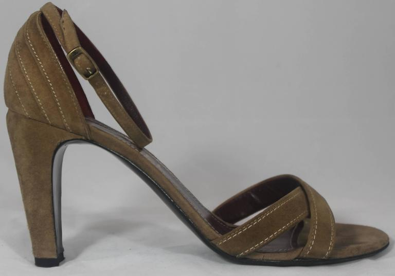 Chanel Tan Suede Strappy Heels with Ankle Strap - 36.5. These beautiful Chanel heels have an ankle strap and criss-crossed straps in the front. There is an engraved Chanel emblem on the ankle buckles. These shoes are in good condition with minor