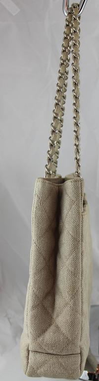 Chanel Beige Raffia Quilted Shopper Tote with Turnkey Lock - SHW - 1997/1998. This beautiful shopper tote is made of quilted beige raffia. It has 2 raffia woven chain straps, 2 large inside zipper pockets, 1 non-zip pocket, and a turnkey lock. It is
