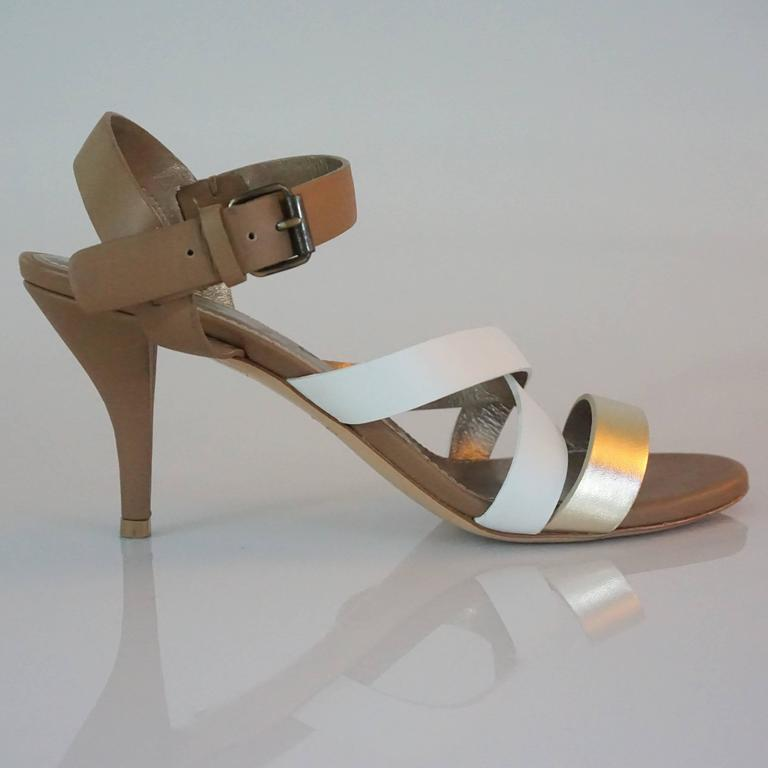 Lanvin Tan/White/Gold Strappy Leather Sandal - 37  This is a great summer sandal, and is very versatile for day or night. The shoe has an ankle strap and three straps across the front, and  is in excellent condition.  Heel Height 3.25
