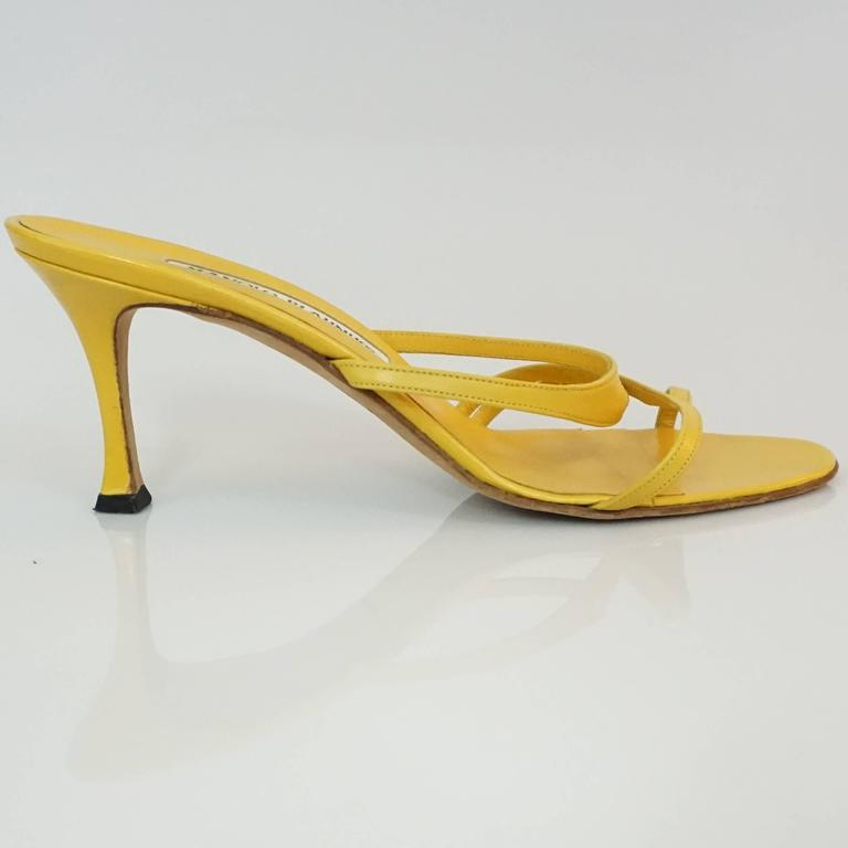 Manolo Blahnik Yellow Leather strappy sandal - 37  This beautiful sandal is the perfect pop of color for any outfit, and great for the summer. The shoe is in excellent condition.   Heel Height 2.75