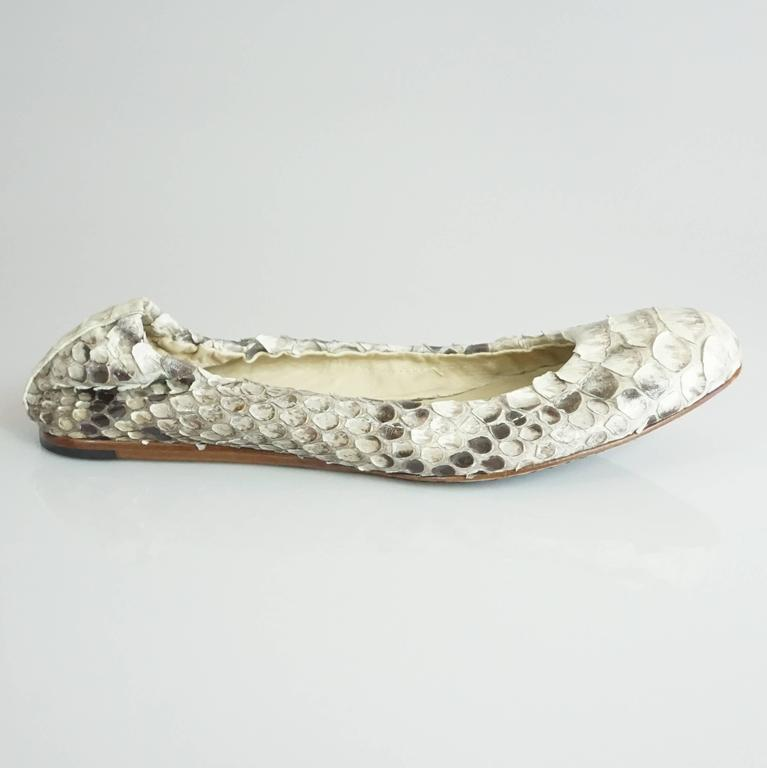 These Alexandre Birman flats are gray and ivory python. The back is stretchy and the toe is rounded. They are in very good condition with some of the scales being lifted and minor bottom wear.