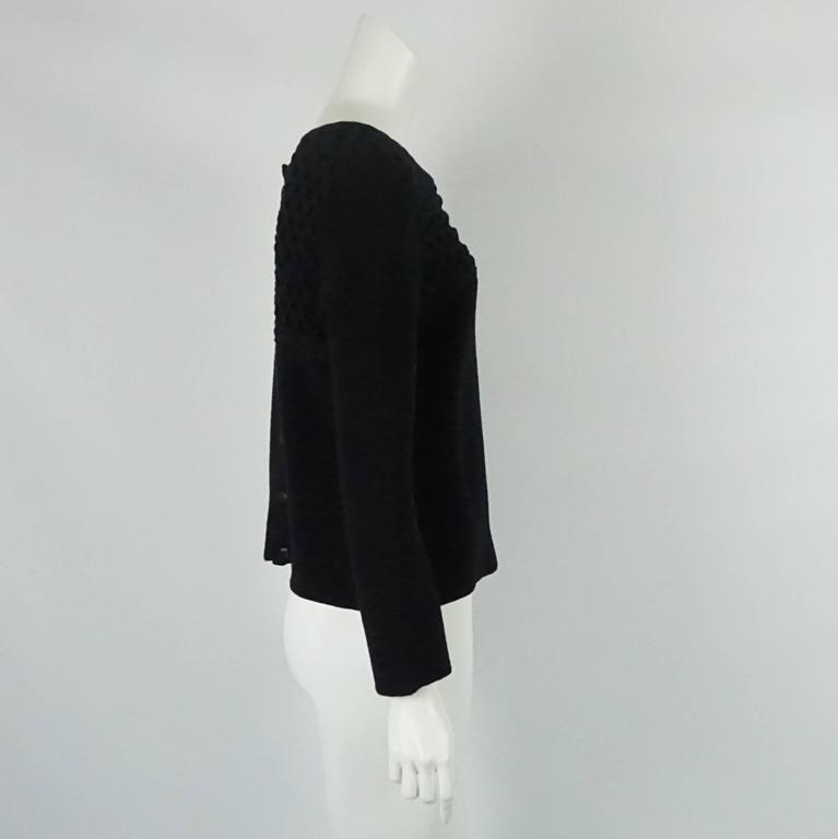 Chanel Black Wool Blend Ribbed Sweater Top - 40. This sweater is a beautiful piece for the cold weather. It is a wool, rayon, and camel hair blend and is in excellent condition with light wear. The sweater is fully ribbed with the neckline area