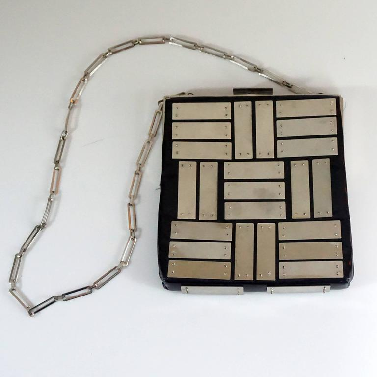 Pierre Cardin Square Black Patent with Silver Panels Shoulder Bag - SHW Circa 60's. This vintage shoulder bag is black patent with silver panels, silver link handle, and silver frame top with a clasp. The lining is black satin and there is 1 small
