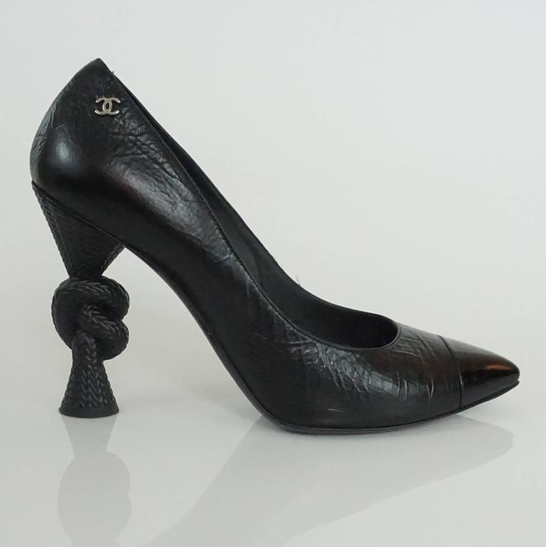 Chanel Black Leather and Patent Pump w/ Rope Heel - 40.5 These spectacular and classy shoes are a distressed leather look with a patent toe, silver cc detail and a rope knot heel. These shoes are in excellent condition.