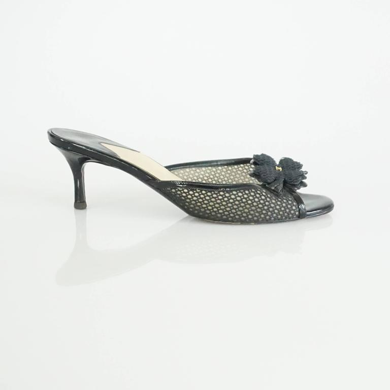 This Chanel black mesh covered slide heels have a clover motif with a small gold CC on them. They are in excellent condition with light wear on the heel as shown in the last image. Size 38.   Heel Height: approx 2.75""